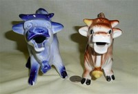 Flow Blue English and Brown Japanese cow creamers of same style, front