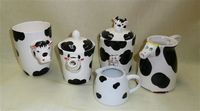 Assortment of 5 black and white cow vessels