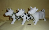 Pier 1 and Wiklliams Sonoma black and white cow creamers