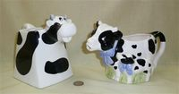 Two black & white cow creamers