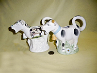 Two English bone china cow caricature creamers with wide open mouths