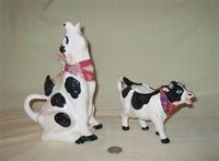 Two 'Desert Doodads' cow creamers