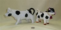 Two black and white cow creamers