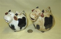 Two Small brown and white caricature cow creamers from Malaysia