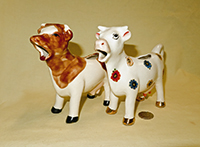 Two cow creamers from same mold as Betsy