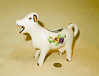 White cow creamer with pansies and gold trim