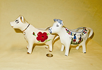 Holley Ross and Erwin Pottery cow creamers, side