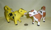 Two paint it yourself cow creamers