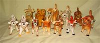 Herd of 12  cow creamers in varying shades of brown
