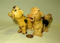 Two small Japanese brown cow caricature creamers