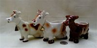 Goebel brown and white cdariucature cow creamer with two look-alikes
