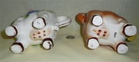 Two UCAGCO cow caricature creamers, bellies