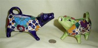 Two Talavera cow creamers from Mexico