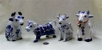 Four blue and white cow creamers