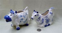 Norcrest and Arnart blue and white cow creamers