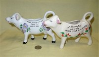 Two souvenir 1/2 pint cow creamers advertising Isle of Mann