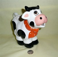 White & black large cow caricature creamer bought in Lima Peru