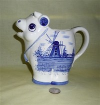Taiwan cow creamer with blue windmill