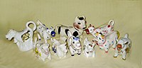 Herd of 10 miscellaneous cow creamers