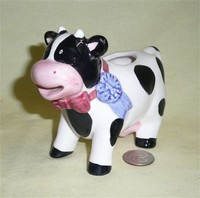 OCI 1995 cow creamer with blue ribbon