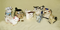 Herd of 7 miscellaneous cow creamers