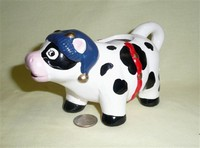 Loomco cow creamer with blue stocking cap