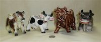 Four interesting Japanese cow creamers