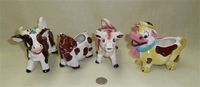 Assortment of 4 Japanese cow creamers
