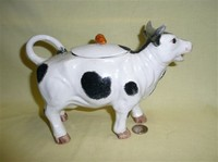 Black and white German cow creamer with lid