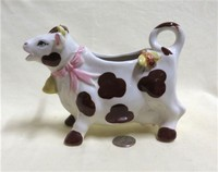 Black & white cow creamer with bee on butt