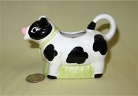Black & white cow creamer with grass fill below belly