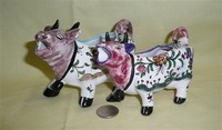 Two purple headed Portuguese cow creamers