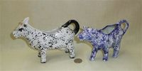 Two speckled cow creamers