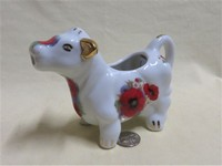 Austin & Maynard pudgy cow creamer with red flowers, side