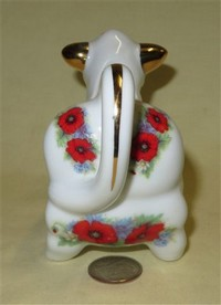 Austin & Maynard pudgy cow creamer with red flowers, butt