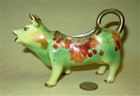 Light green porcelain cow creamer by I.E.&C. Co of Japan, side