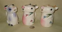 Two ARDCO flat topped cow creamers and a third