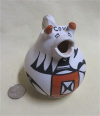 Acoma cow creamer by E.V. with 'cow' on forehead