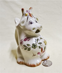 Sitting up cow caricature creamer