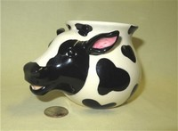 Black and white cow head creamer