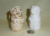 2 small monk cow creamers