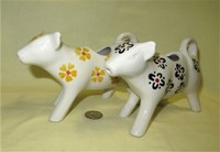 Two Nordstrom's white cow creamers with flowers