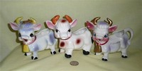 Three 'cute' cow creamer variants