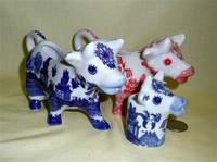 Three cow creamers with willow markings