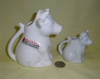 Australian and Dansk white sitting up cow creamers
