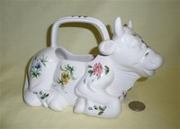 Kneeling white Italian cow creamer with handle and flowers