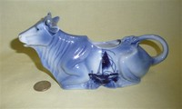 Kneeling cow creamer in Delft style