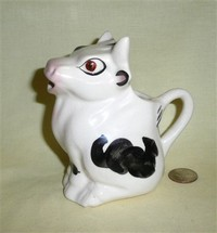White with black sitting up bull creamer by Coventry