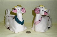 Two Japanese heavy ceramic cow caricature creamers