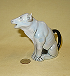 Trico Japanese pre-WWII sitting cow creamers